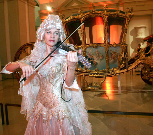 Ute Passionflower palying violin at  a private United Nations event in Vienna