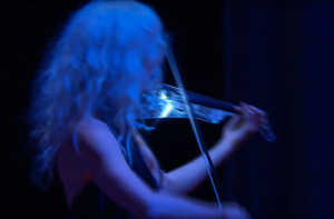 Ute Passionflower performing with her glowing electric violin (5 string Vivo)